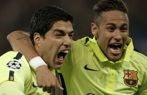 Barcelona's Luis Suarez, left, celebrates with Neymar after scoring his team's second goal during the quarterfinal first leg Champions League soccer match between Paris Saint Germain and Barcelona at the Parc des Princes stadium in Paris, France, Wednesday, April 15, 2015. (AP Photo/Christophe Ena)